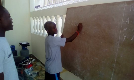 Youth Leader tutoring at Transitional Safehouse