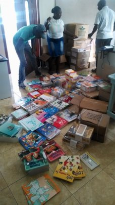 Staff sorting and stamping school books