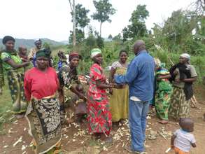 CEO chatting with few beneficiaries of the Project
