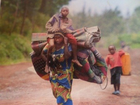 Widow woman on her way back with 2 children