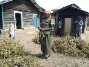 Widow woman cleaning up front of her house
