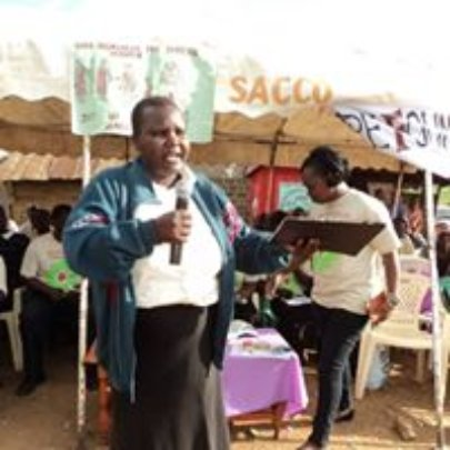 Gladys with Anti-FGM messages at a market event