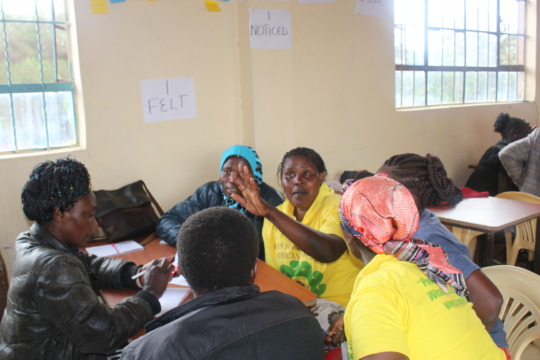 Trainees sharing experiences in group session