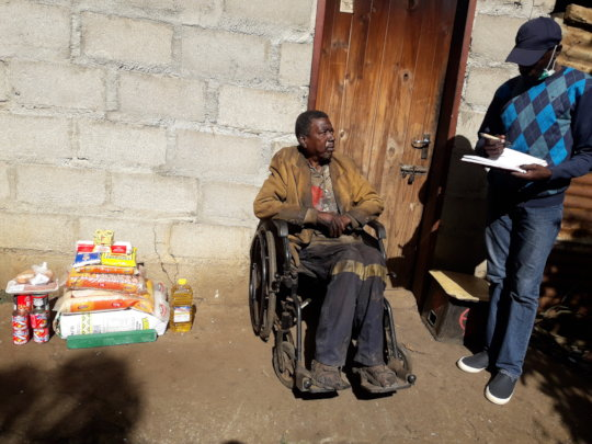 Pastor Bheki with one of the beneficiaries