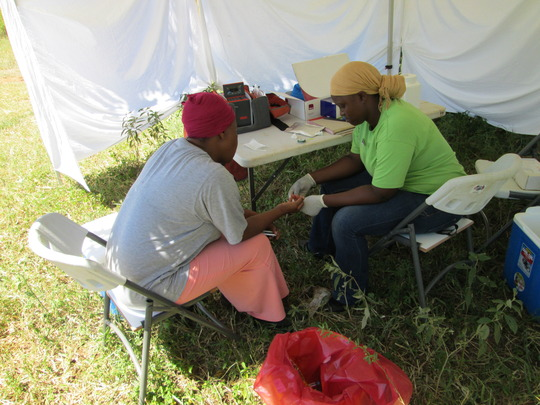 Counsellor drawing a blood sample for HIV testing
