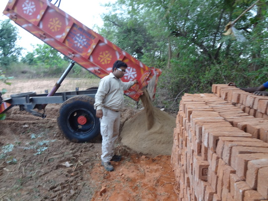 Sand and bricks being unloaded for construction