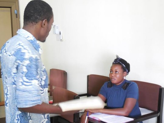 A PISL student working with a tutor