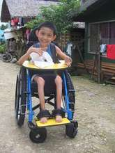Provision of supportive seating wheelchair to a CP