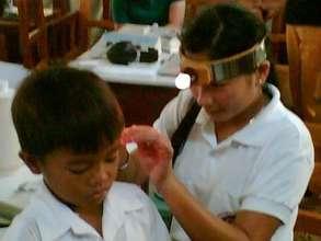 Ear Screenings to Grade School Children