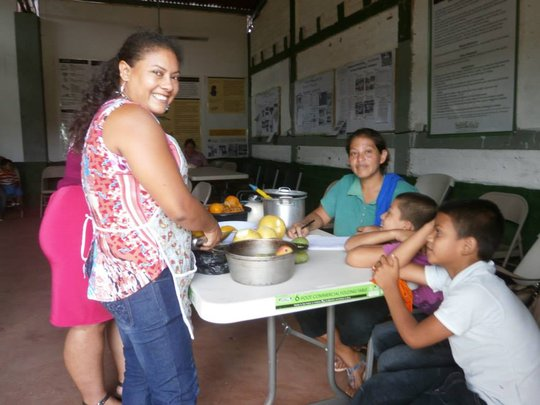 Ana and her children learn to preserve fruits.