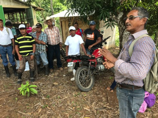 Los Chiles Coop leader, Isidro, talking to farmers