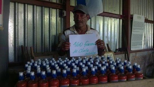 Teofilo displays bottles of his sauce
