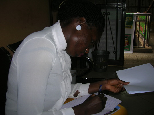 Eve writing a letter to her Globalgiving helpers