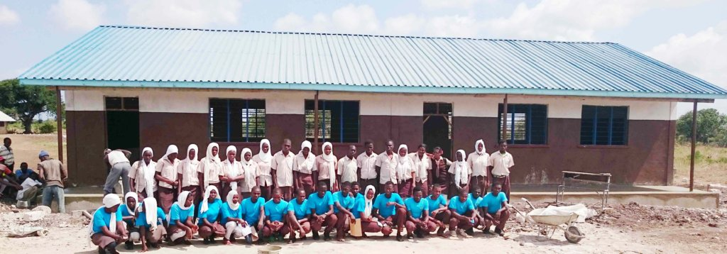 Students outside a completed building
