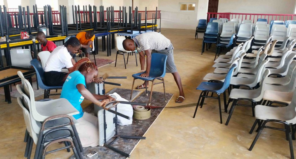 Preparing the chairs for Buyani Secondary
