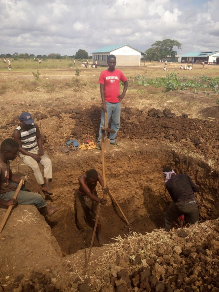 Digging the hole for the pit toilet