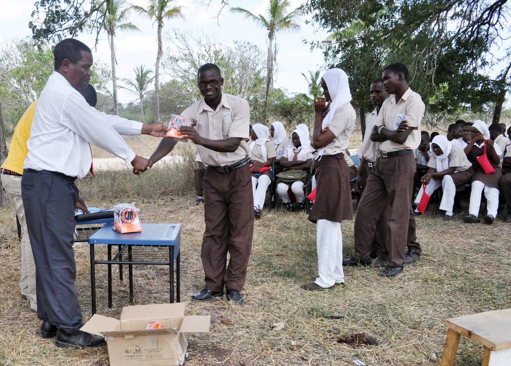Distributing Solar Lamps to students at Buyani