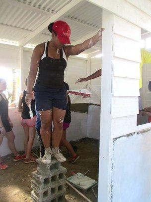 Volunteer working on building shack