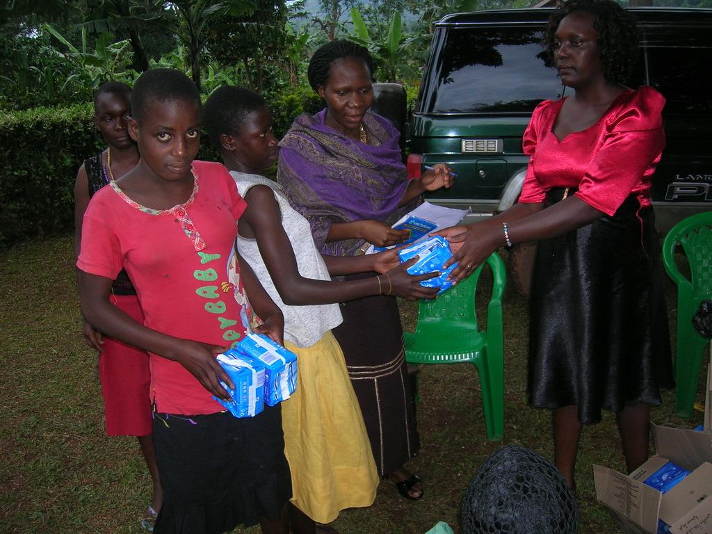 Girls receiving their sanitary pads