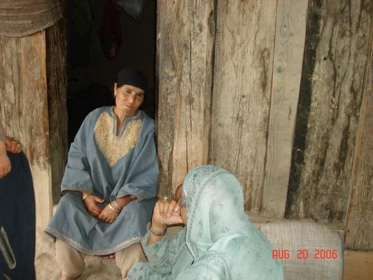 A woman sharing her problems with a KER volunteer
