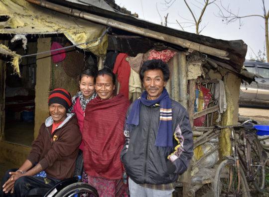Bishal (far left) and his grateful family