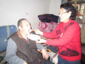 the senior was feeding the older senior dumplings