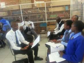 Students compiling project proposal