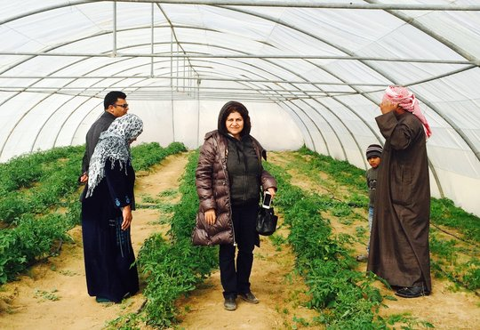 Yanar Mohammed(center) leader of OWFI at the farm.