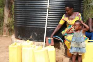 Mother and daughter selling water