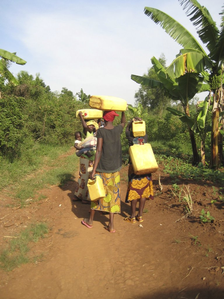 Women walk long distances to unsafe water sources