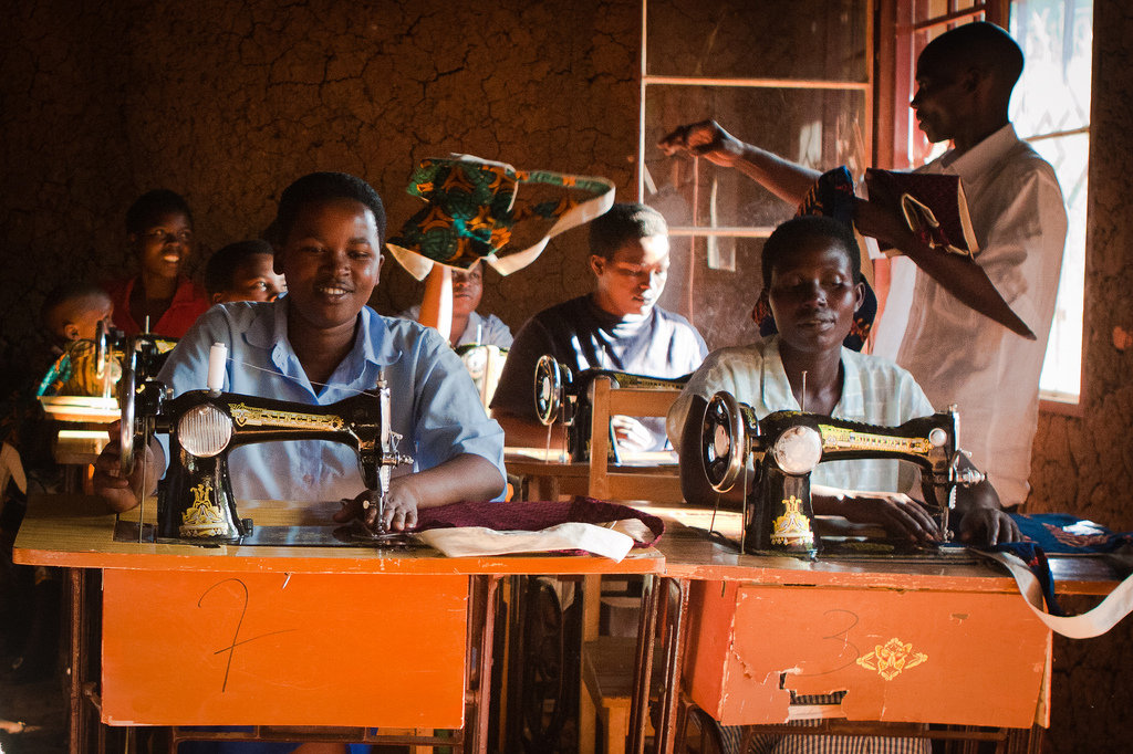 These women are sewing bags to sell at markets and hotels in Kigali as part of the Community Vocational Training School project, which gives former prostitutes an alternative source of income by teaching them how to sew. For these women, the sewing machines are the key to a better, safer life.
