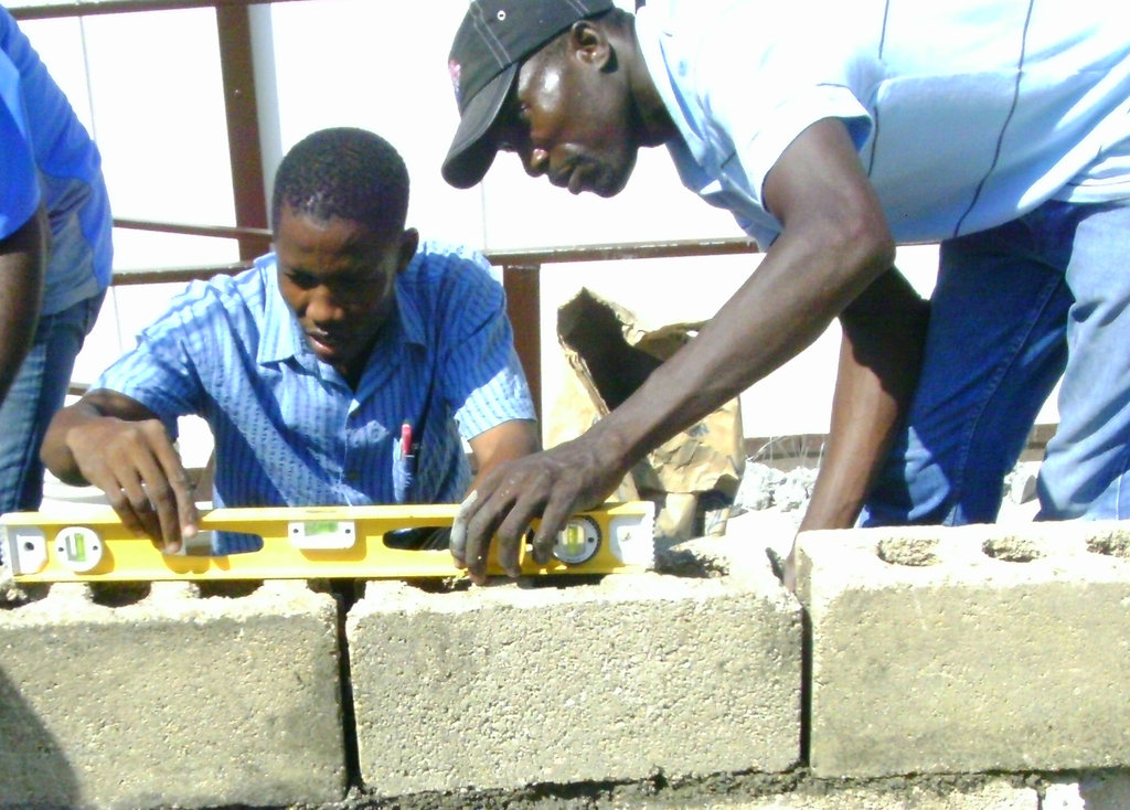 Train four builders in Haiti to build safe homes
