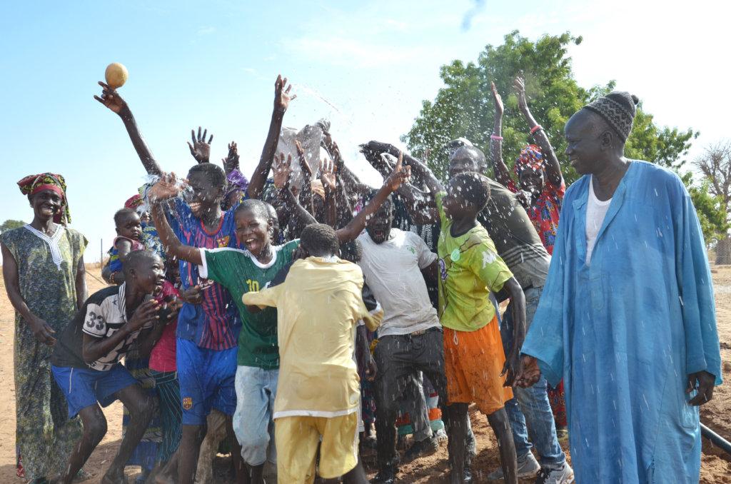 Community members celebrating water in Diabel