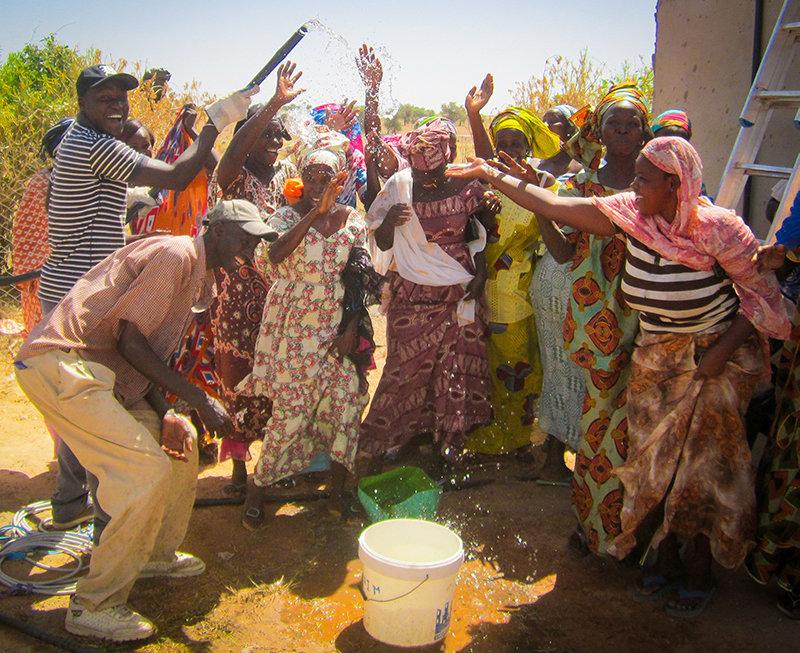 Community members in Santhie celebrating water