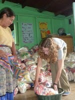Volunteers help to distribute the parcels