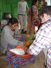 Giving food to a grandparent in Itzapa