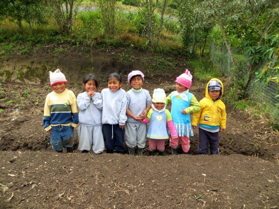 Children working in the veggie garden in Ecuador