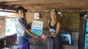 Donation of Telephone cards to villager