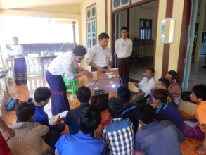 Solar Advisers(candidate) teaching villagers