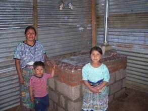 Catalina's family with their finished stove
