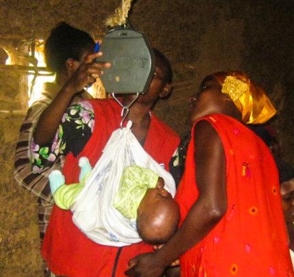 Babies being weighed at immunization