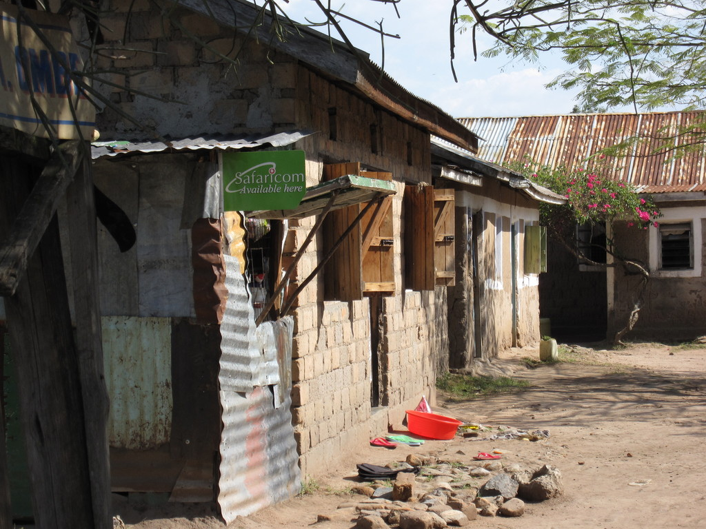 Typical slum dwelling. Note the Safaricom for sale