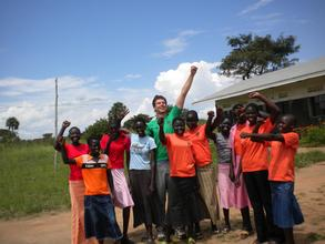 """Colin and NESEI girls are excited on """"Plant A Tree in Yei Day."""""""