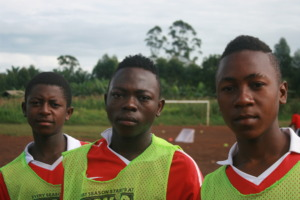 Babila, center, with teammates