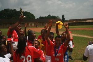 Kumba girls raise the championship cup!