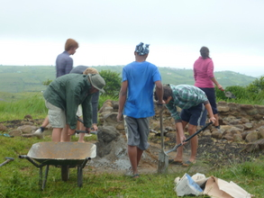 Volunteers working on the new building