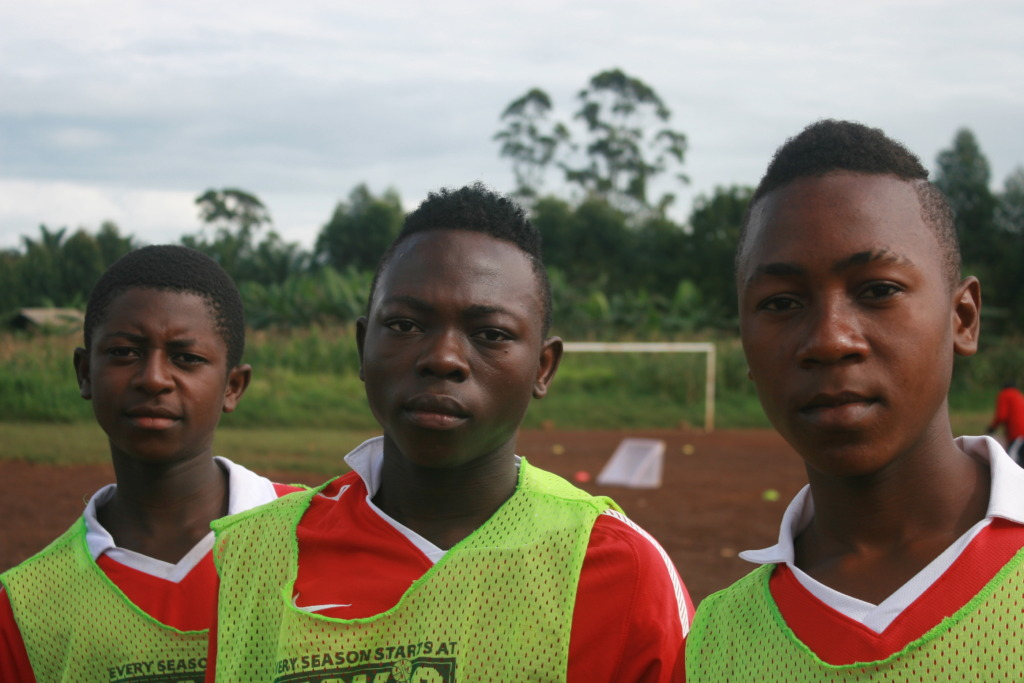 Babila (Center) with teammates