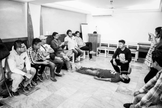 Hector, an alum, gives a safety briefing in Mexico