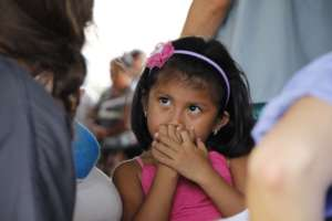 Shy but trusting; a little girl talks to our docs