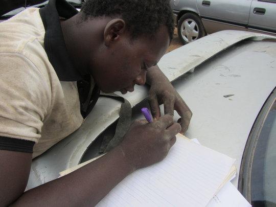 Auwal Practicing His Writing Skills